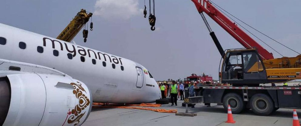 PHOTO: A Myanmar National Airlines flight landed safely with no front landing gear at Mandalay International Airport, May 12, 2019.