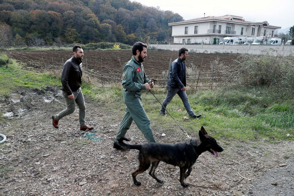 PHOTO: Turkish police officers with a sniffer dog examine outside of a villa in the Samanli village of the Termal district in the northwestern province of Yalova, Turkey, Nov. 26, 2018.