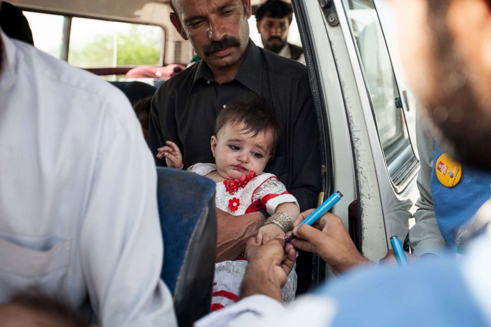 PHOTO: A team works at a polio-vaccine transit post at a checkpoint in northwest Pakistan.