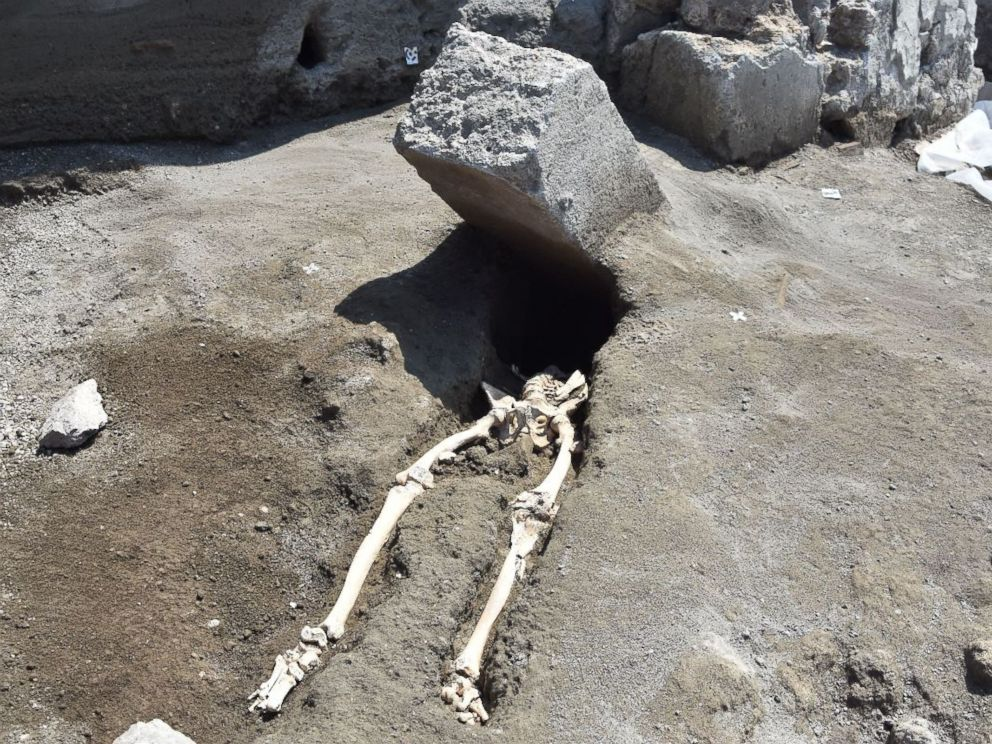 Skeleton of Roman beheaded by large flying rock slab discovered at Pompeii