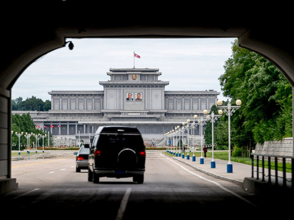 The motorcade carrying U.S. Secretary of State Mike Pompeo drives towards Kumsusan Palace of the Sun in Pyongyang North Korea Friday