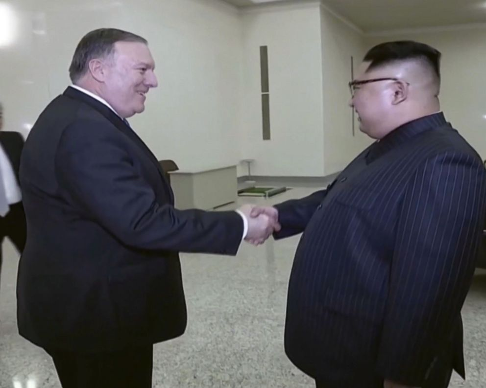 PHOTO: A scene shown on North Korean state TV of U.S. Secretary of State Mike Pompeo shaking hands with North Korean President Kim Jong Un, May 9, 2018.
