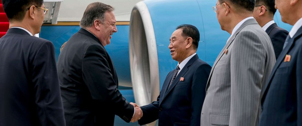 PHOTO: U.S. Secretary of State Mike Pompeo, second from left, is greeted by North Korean Director of the United Front Department Kim Yong Chol as he arrives at Sunan International Airport in Pyongyang, North Korea, July 6, 2018.