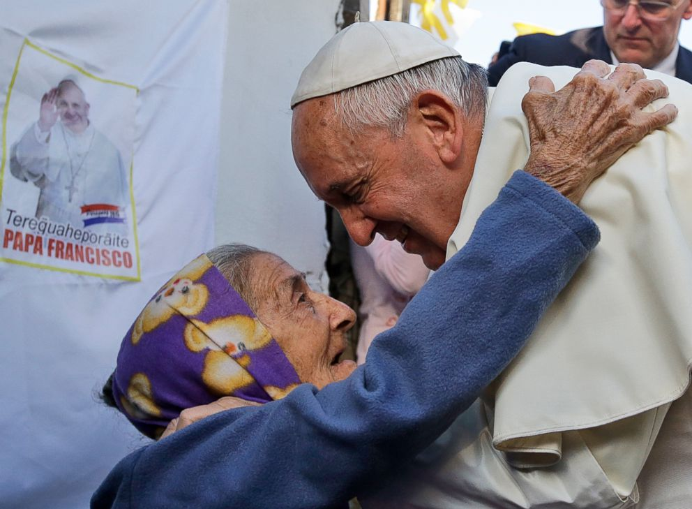 PHOTO: Pope Francis is greeted by an elderly woman during his visit to the Banado Norte neighborhood in Asuncion, Paraguay, on July 12, 2015.