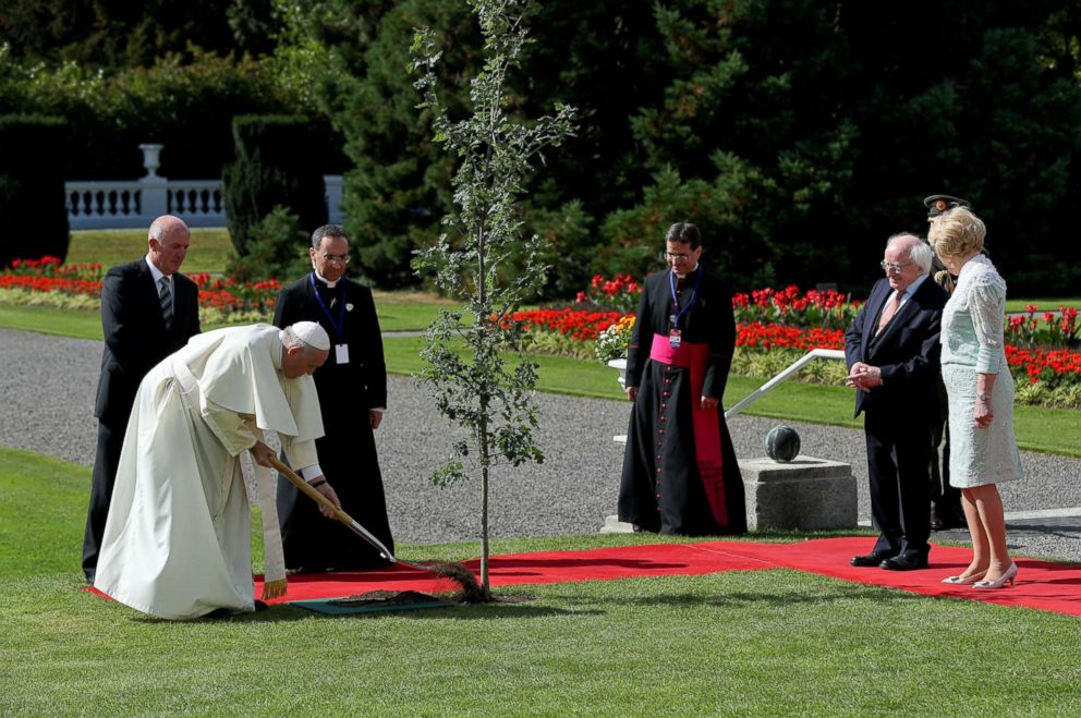 Pope Francis during a tree planting ceremony with President of Ireland Michael D. Higgins (2nd R) and his wife Sabina Coyne (R) at Aras an Uachtarain on Aug. 25, 2018 in Dublin, Ireland.