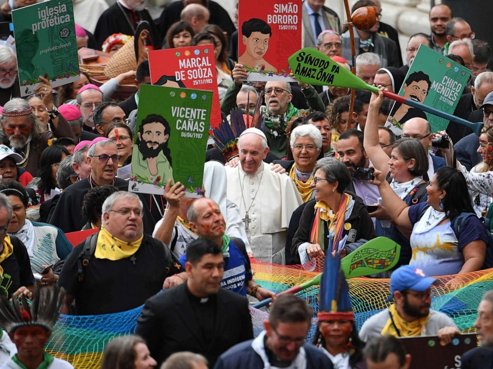 PHOTO: Representatives of the Amazon Rainforests ethnic groups and Pope Francis march in procession during the opening of the Special Assembly of the Synod of Bishops for the Pan-Amazon Region, Oct. 7, 2019, outside St. Peters Basilica in the Vatican.