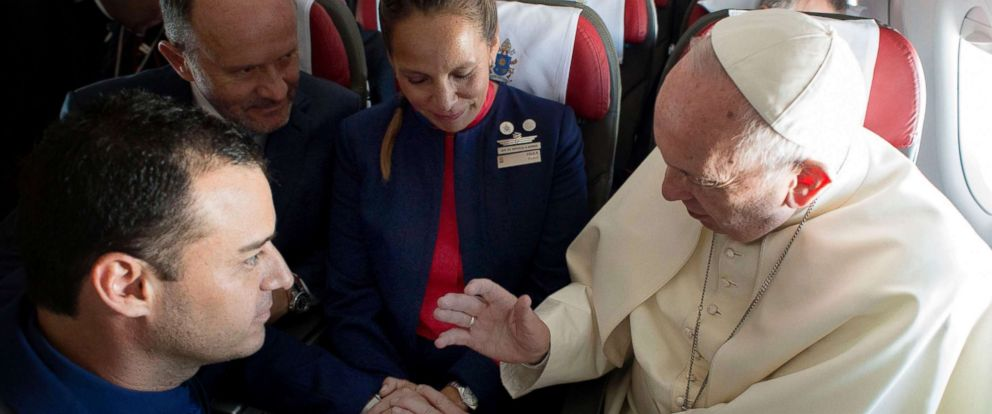 PHOTO: Pope Francis marrying Latam airline flight attendants Carlos Ciuffardi, far left, and Paula Podest, center, during the flight between Santiago and Iquique, Jan. 18, 2018. One of the owners of the airline, Ignacio Cueto, second left, looks on.