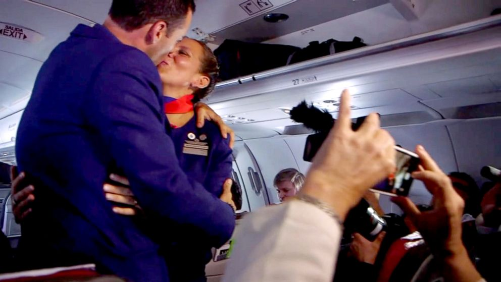 PHOTO: Flight attendent Carlos Ciuffardi, left, kisses his bride Paula Podest. Pope Francis married them on a flight from Chiles capital, Santiago, to Iquiqe, Chile, Jan. 18, 2018.