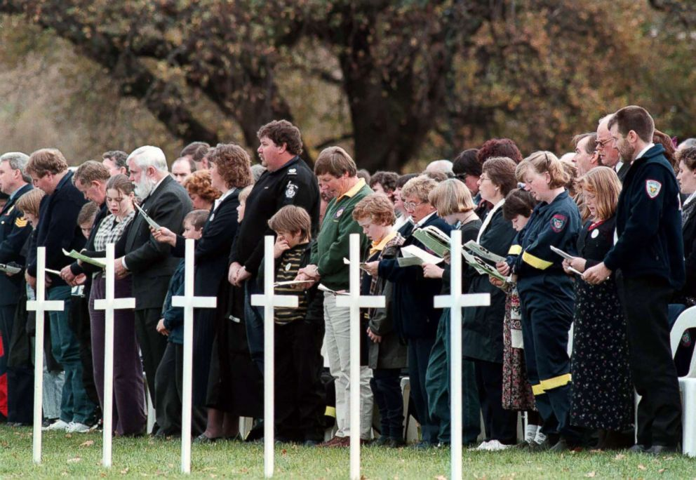 PHOTO: People express their respect for the memorial service held at the historic site in Port Arthur for the 35 victims of the massacre in Port Arthur on May 19, 1996.