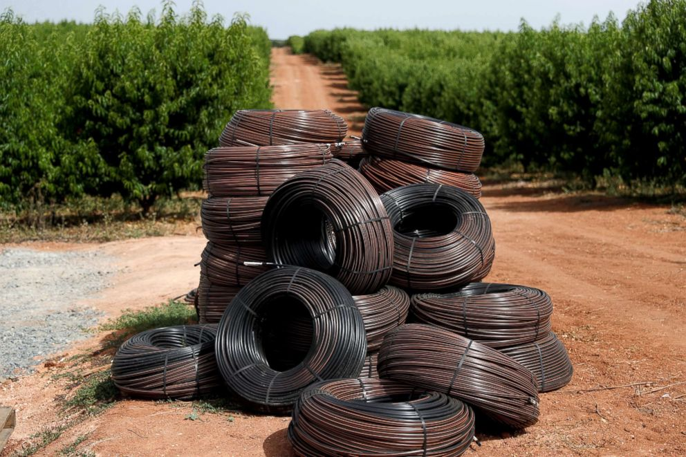 PHOTO: Hoses for irrigation systems are stacked before being installed in an intensive olive plantation near Portel, Portugal, Aug. 2, 2018.