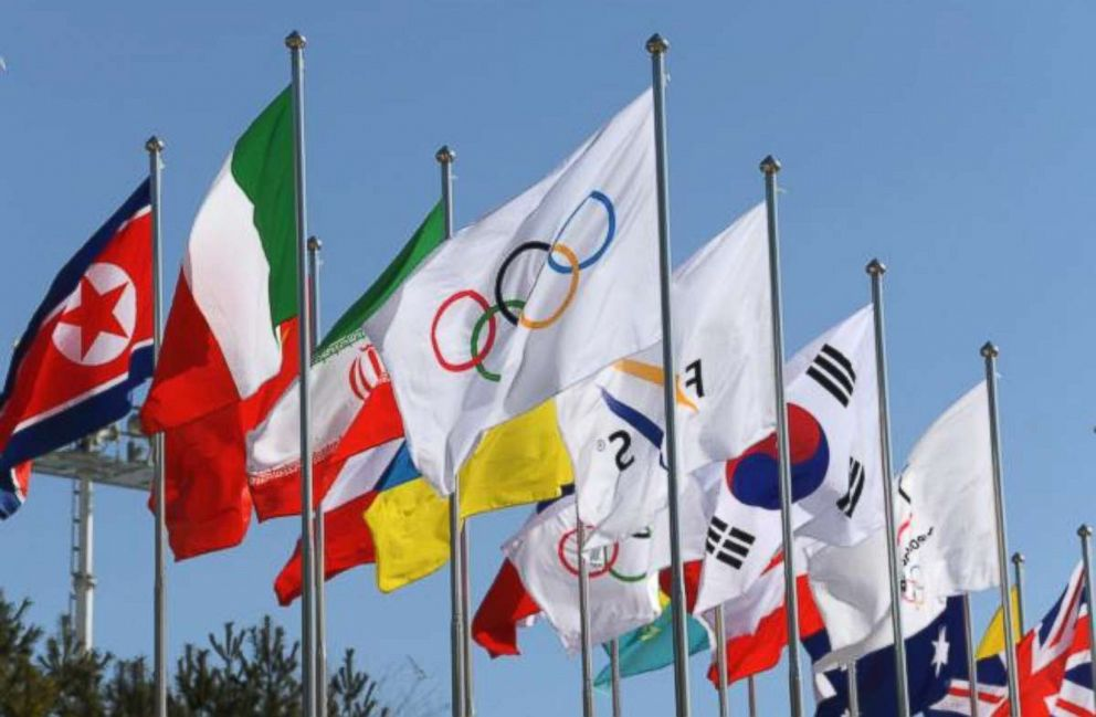 The Olympic flag surrounded by flags from various countries that are competing in the Winter Olympics wave in the wind in front of the Olympic Stadium in Pyeongchang South Korea Feb. 7 2018