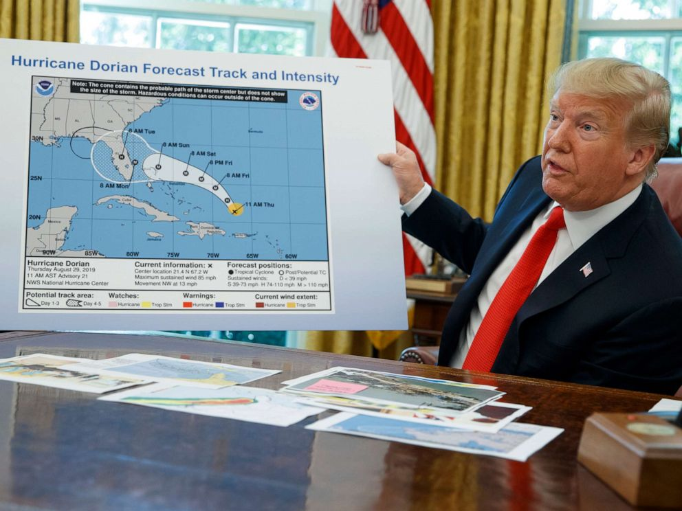 PHOTO: President Donald Trump talks with reporters after receiving a briefing on Hurricane Dorian in the Oval Office of the White House, Sept. 4, 2019, in Washington.