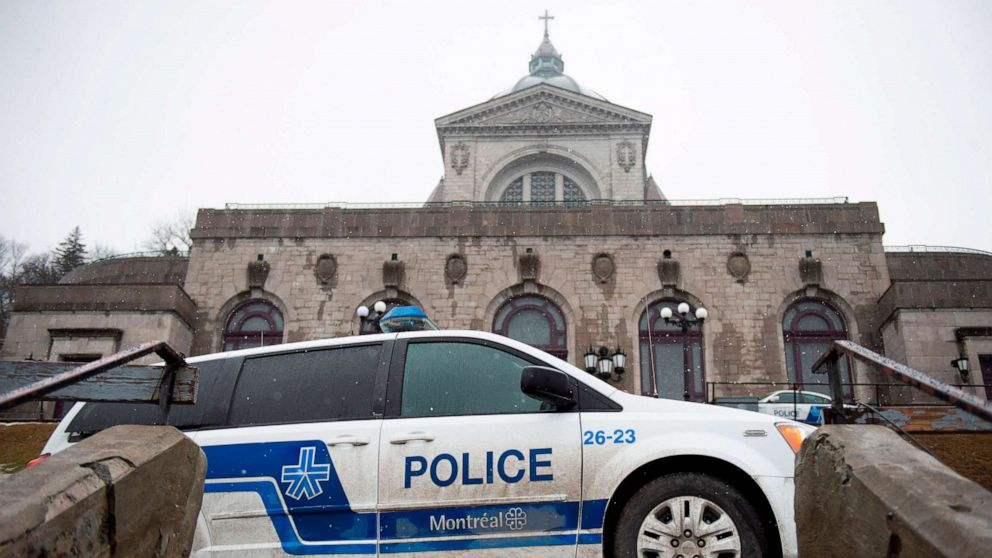 Police provide security at Saint Joseph's Oratory in Montreal on March 22, 2019, after Catholic priest Claude Grou was stabbed during a livestreamed breakfast.