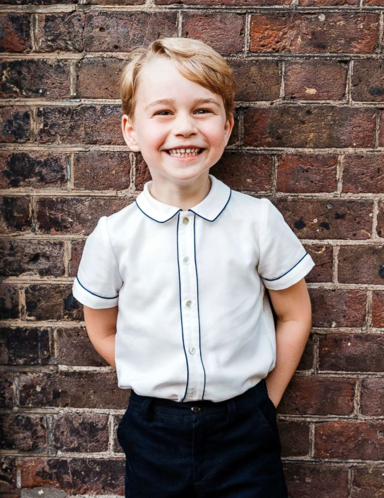 PHOTO: In this photo taken July 9, 2018, Britains Prince George poses for a picture following the christening of his brother Prince Louis, at Clarence House in London.