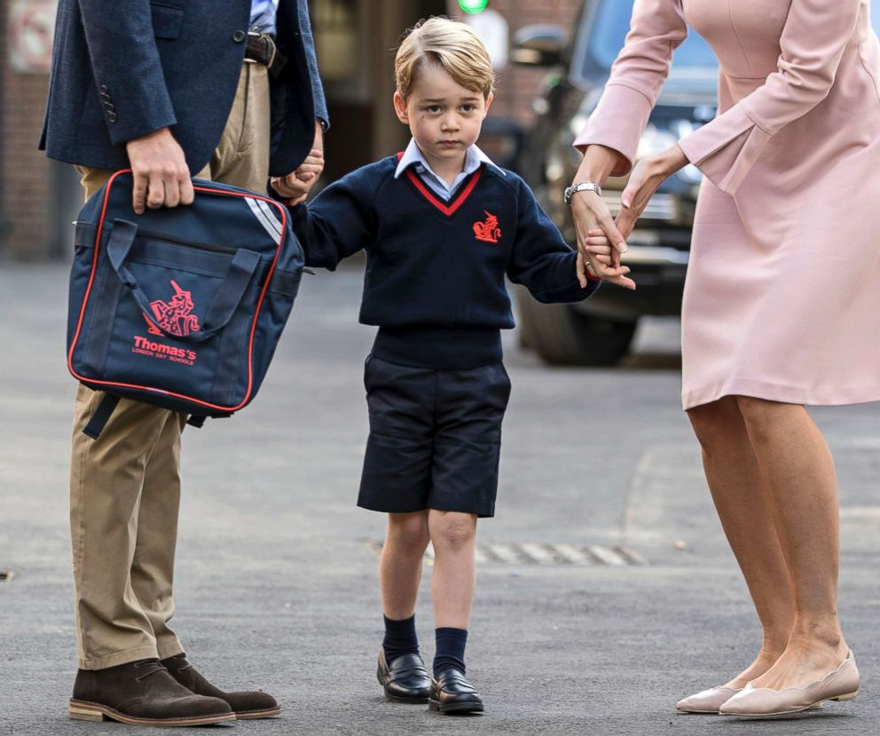 PHOTO: Britains Prince William accompanies Prince George as he is met by Helen Haslem - the head of the lower school on arrival for his first day of school at Thomass school in Battersea, London, Sept. 7, 2017.