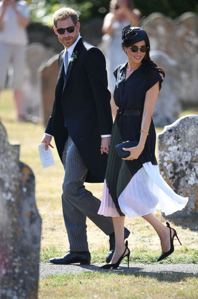 PHOTO: The Duke and Duchess of Sussex walk outside St. Mary the Virgin Church in Frensham, Surrey, after attending the wedding of Charlie van Straubenzee and Daisy Jenks, Aug. 4, 2018.