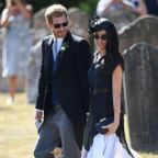 The Duke and Duchess of Sussex walk outside St. Mary the Virgin Church in Frensham, Surrey, on Aug. 4, 2018, after attending the wedding of Charlie van Straubenzee and Daisy Jenks.