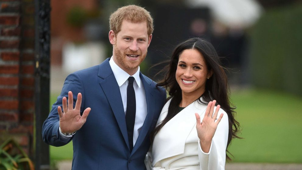 Britain's Prince Harry poses with his fiancee Meghan Markle during a photocall after announcing their engagement in the Sunken Garden at Kensington Palace in London, Nov. 27, 2017.
