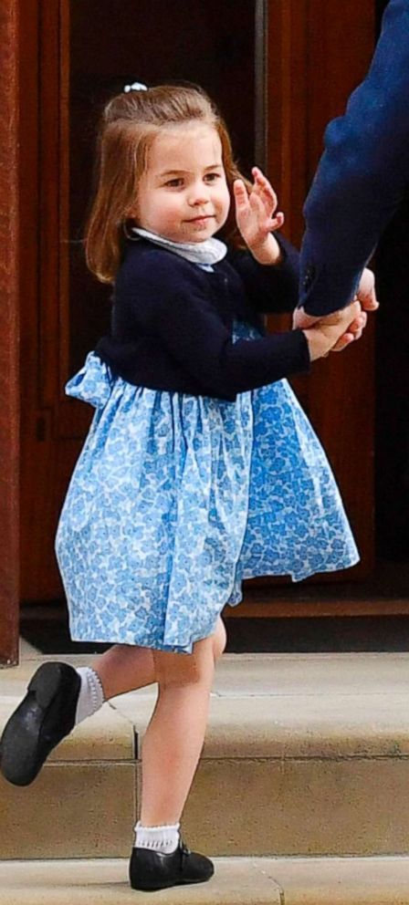 PHOTO:Princess Charlotte of Cambridge turns to wave at the media a by her father Britains Prince William, Duke of Cambridge, at the Lindo Wing of St Marys Hospital in central London, April 23, 2018.