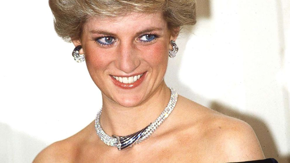 Princess Diana poses in Bonn, Germany, wearing sapphire and diamond jewels which were a gift from the Sultan of Oman (the Tiara is her own) with a dress designed by Victor Edelstein.