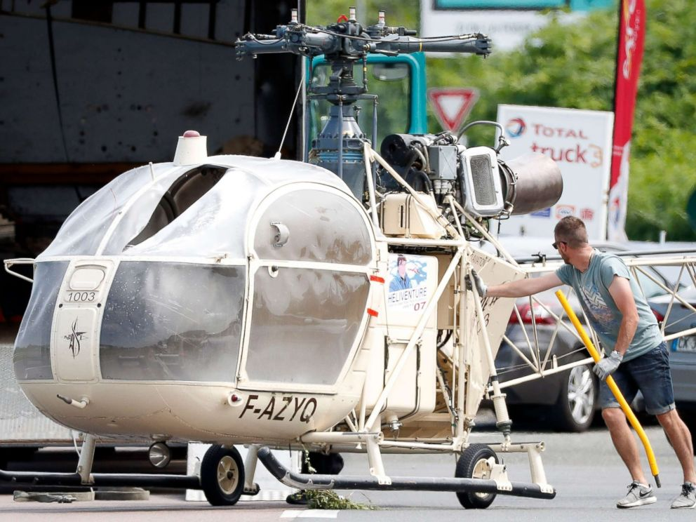 PHOTO: Investigators transport an Alouette II helicopter allegedly abandoned by French prisoner Redoine Faid and suspected accomplices after his escape from the prison of Reau, in Gonesse, north of Paris, July 1, 2018.