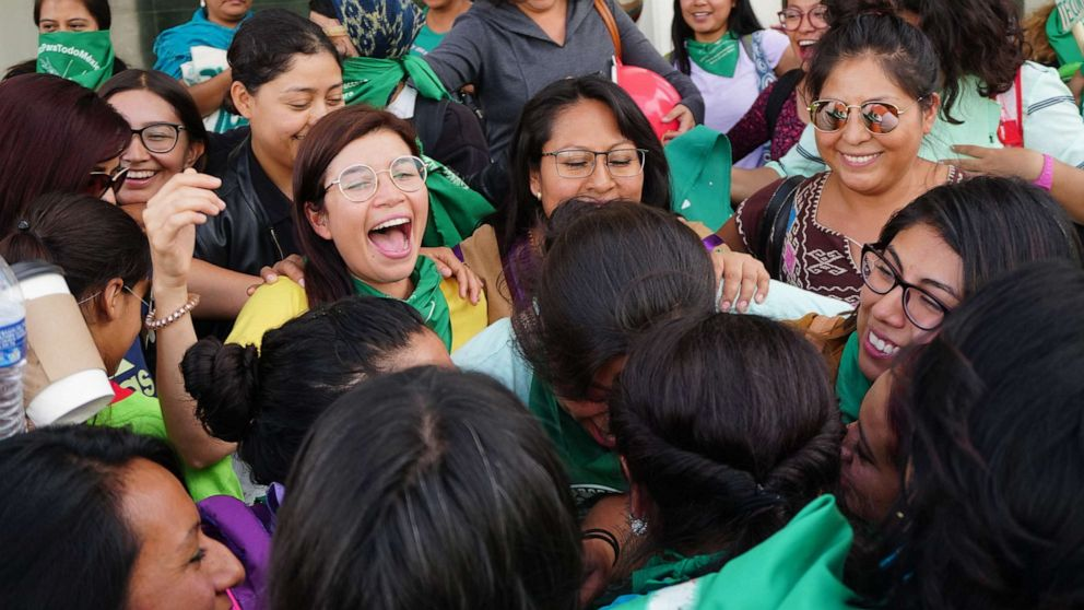 PHOTO: Feminists of the so-called Green Tide celebrate and wave handkerchiefs after the Oaxaca State Congress decriminalized abortion by approving an opinion authorizing the legal termination of pregnancy before 12 weeks gestation, in Oaxaca, Mexico.