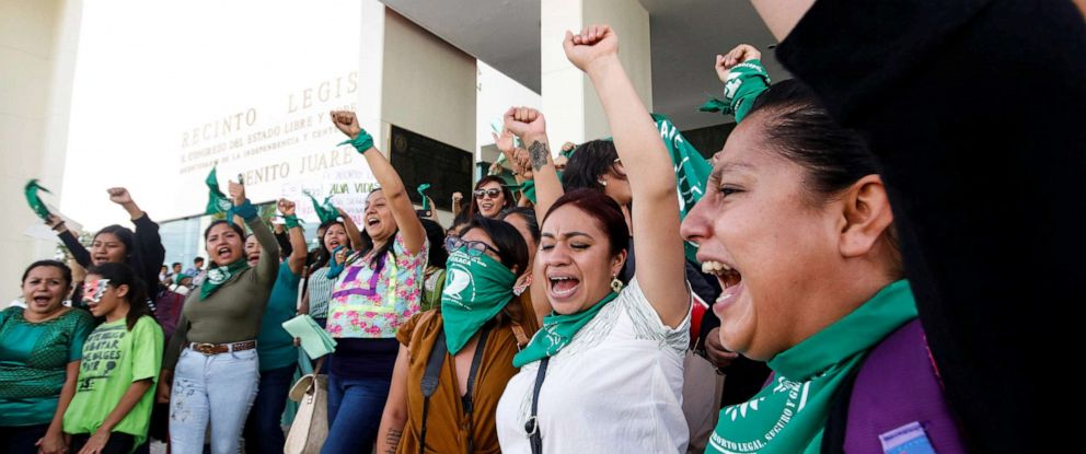 PHOTO: Pro-choice demonstrators celebrate after lawmakers passed a legislation that decriminalizes abortion, outside the local congress in Oaxaca, Mexico Sept. 25, 2019.