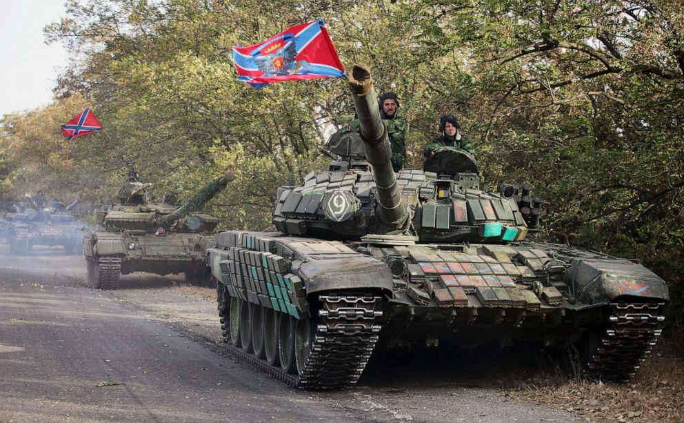 PHOTO: Pro-Russian separatist soldiers withdraw their tanks from position near town of Novoazovsk in Donetsk region, Oct. 21, 2015.