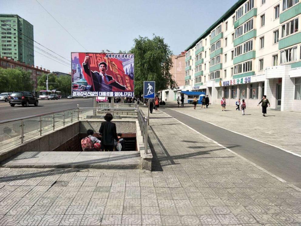 PHOTO: A propaganda poster near a pedestrian underpass on Ryomyong Street, Pyongyang, North Korea, August 2018.