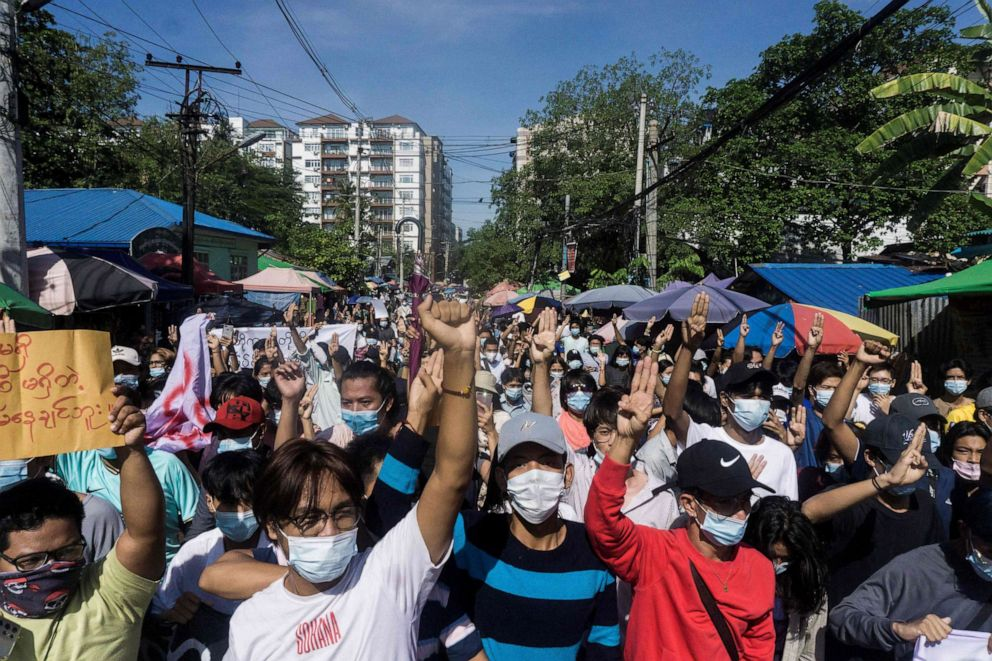 PHOTO: Protesters make the three-finger salute during a demonstration against the military junta in Yangon, Myanmar, on May 14, 2021.