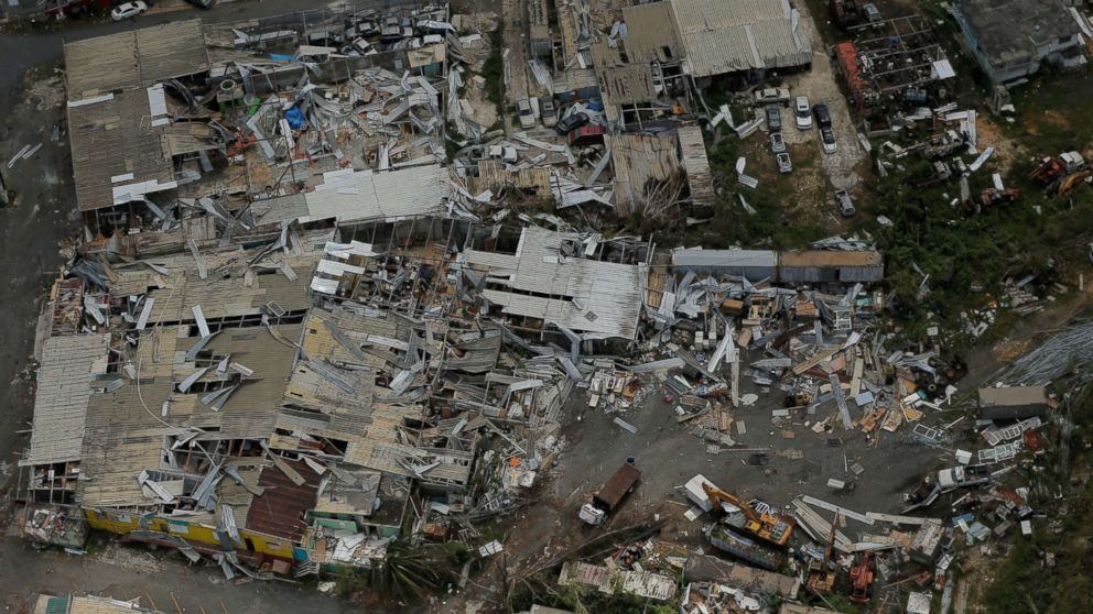 Aluminum roofing is seen twisted and thrown off buildings as recovery efforts continue following Hurricane Maria near San Jose, Puerto Rico, Oct. 7, 2017.