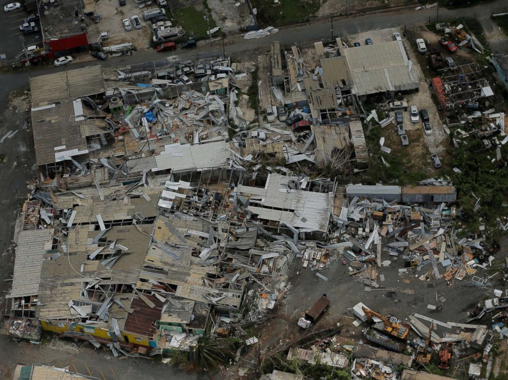 PHOTO: Aluminum roofing is seen twisted and thrown off buildings as recovery efforts continue following Hurricane Maria near San Jose, Puerto Rico, Oct. 7, 2017.