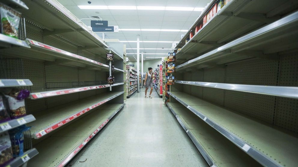Beverage shelves stand mostly empty in a Walgreen's store over three weeks after Hurricane Maria hit the island, Oct. 13, 2017 in San Juan, Puerto Rico.