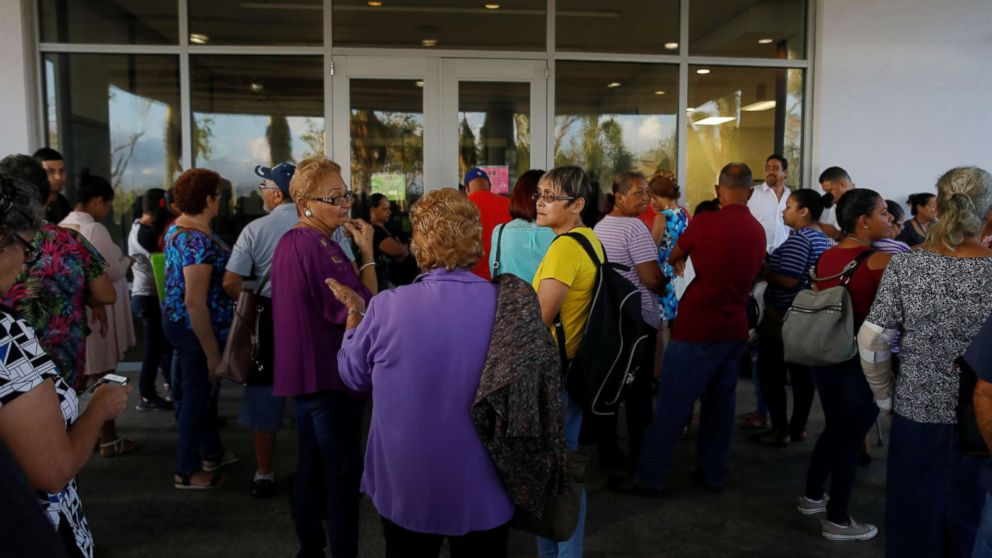 Residents affected by Hurricane Maria wait for medical specialists to arrive at the HIMA San Pablo Hospital in the municipality of Caguas, outside San Juan, Puerto Rico, Oct. 13, 2017.