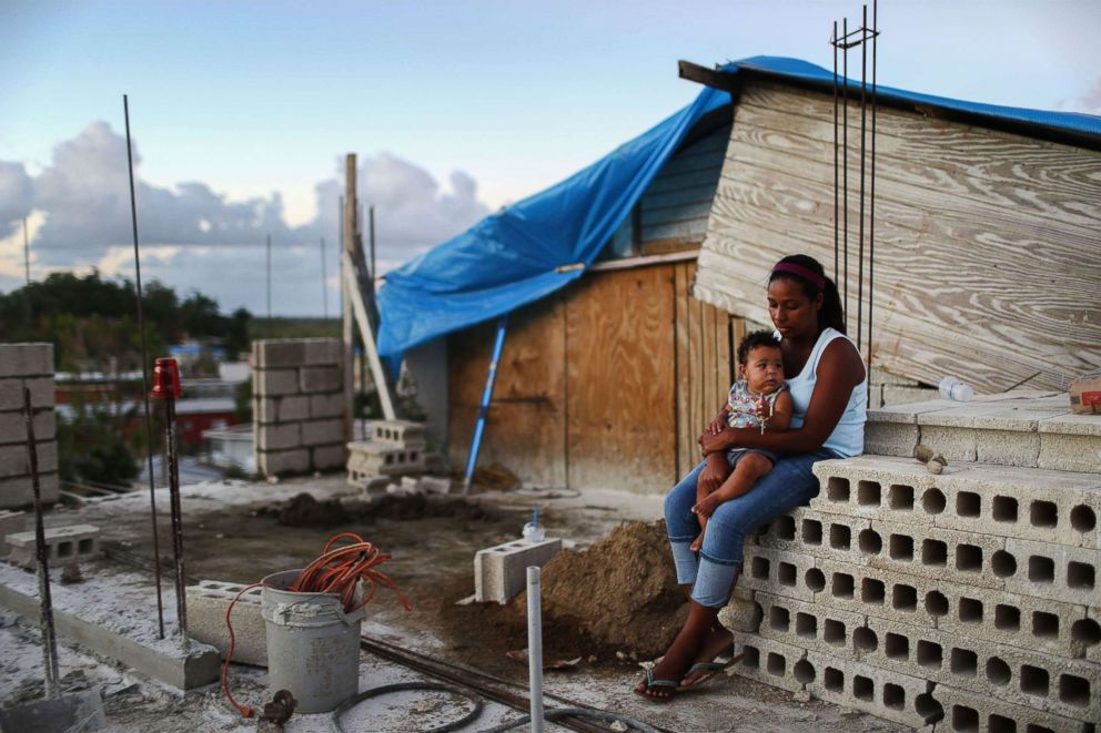 PHOTO: Mother Isamar holds her baby Saniel at their home under reconstruction following Hurricane Maria, Dec. 23, 2017 in San Isidro, Puerto Rico. Their neighborhood remained without electricity nearly three months after Hurricane Maria made landfall.