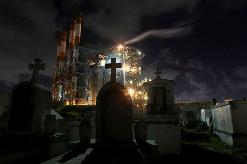 PHOTO: Central Palo Seco power station of the Puerto Rico Electric Power Authority (PREPA) is seen behind a cemetery, in San Juan, Puerto Rico, Jan. 22, 2018.
