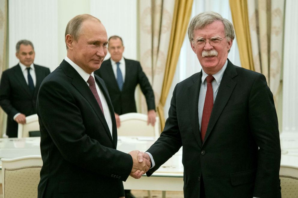 PHOTO: Russian President Vladimir Putin, left, shakes hands with US National security adviser John Bolton during their meeting in Moscow, June 27, 2018.  Trump, Putin to hold summit: Kremlin putin bolton epa jef 180627 hpEmbed 3x2 992