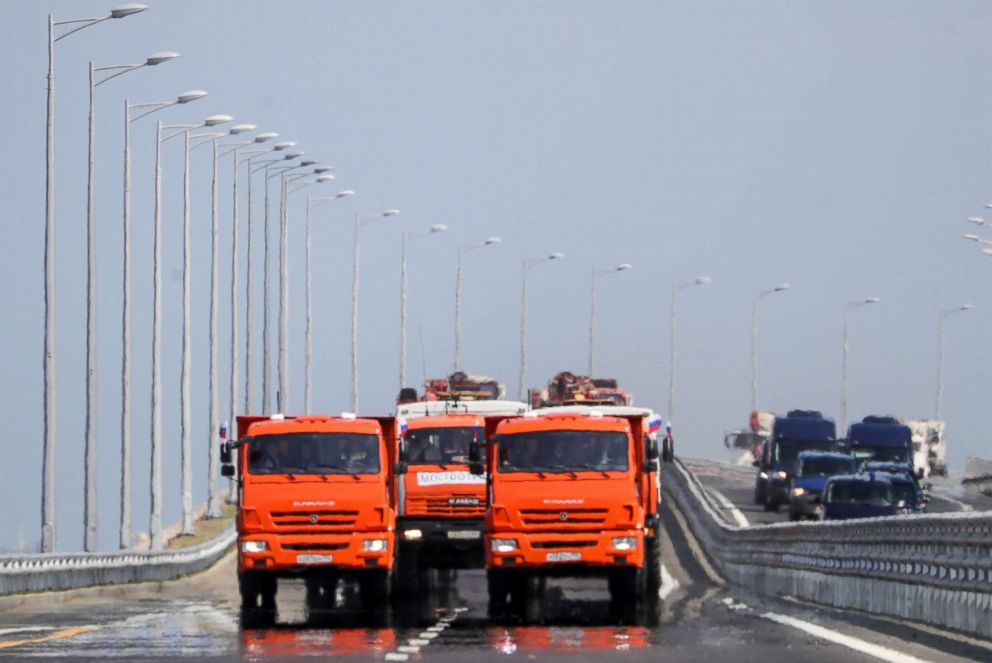 PHOTO: A convoy of construction machines passing through the Kerch Strait (Crimean) Bridge, May 15, 2018, in Kerch, Russia.