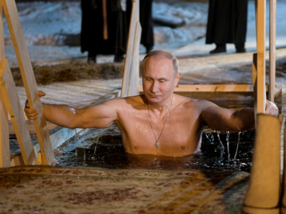 PHOTO: Russias President Vladimir Putin dips in the icy waters of Lake Seliger during the celebration of Epiphany.