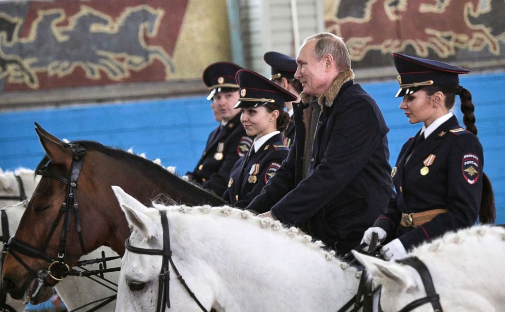 PHOTO: Russian President Vladimir Putin rides a horse on a visit to a mounted police unit in Moscow, March 7, 2019.