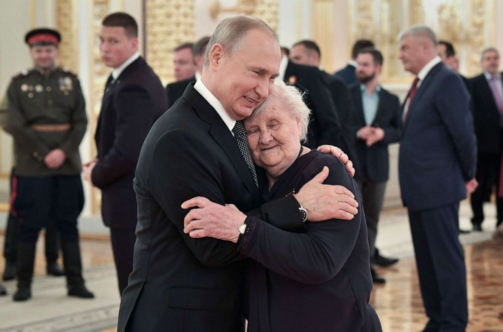 PHOTO: Russian President Vladimir Putin embraces his teacher, Vera Gurevich, at a reception marking the 74th anniversary of the victory over Nazi Germany, at the Kremlin in Moscow, May 9, 2019.