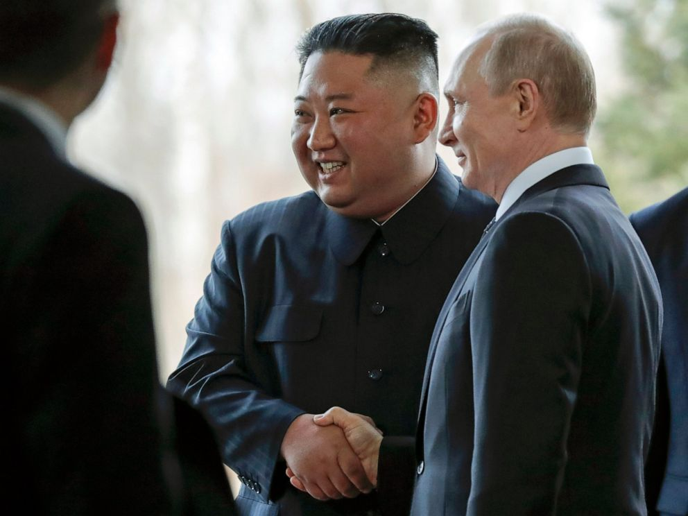 PHOTO: Russian President Vladimir Putin, right, and North Koreas leader Kim Jong Un shake hands during their meeting in Vladivostok, Russia, Thursday, April 25, 2019.