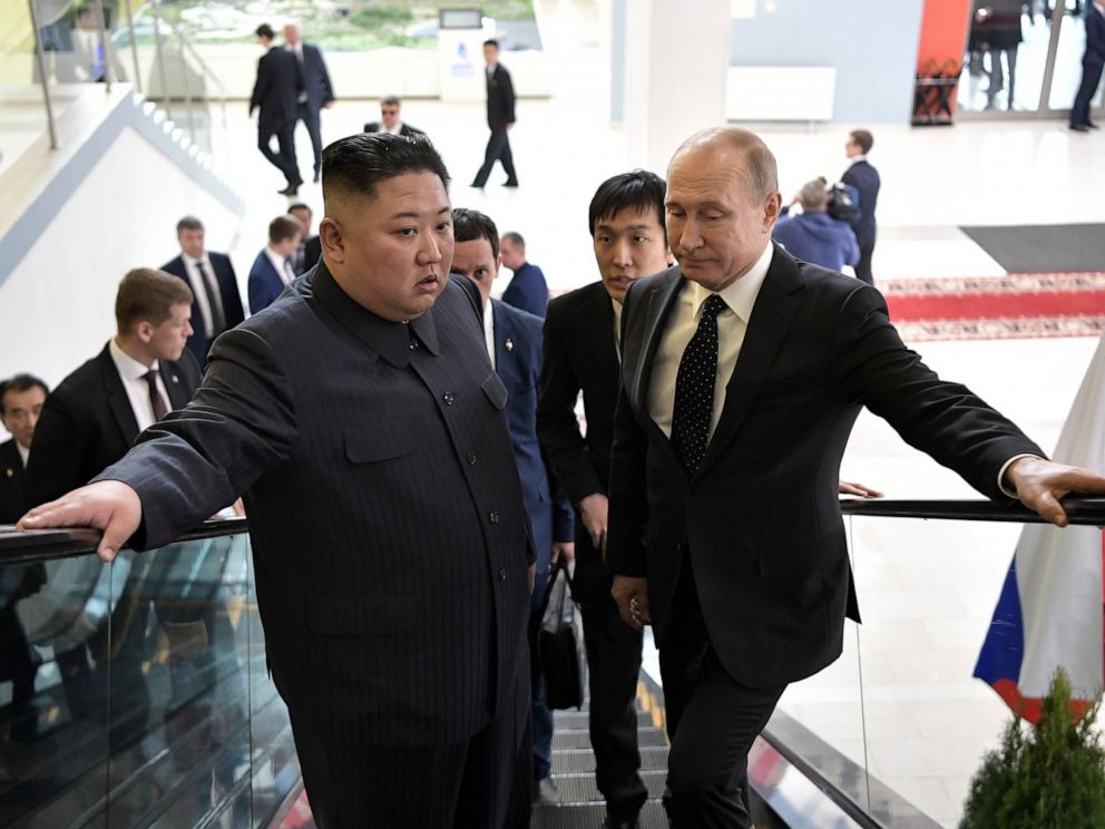 PHOTO: Russian President Vladimir Putin, right, and North Koreas leader Kim Jong Un take an escalator heading to the talks in Vladivostok, Russia, Thursday, April 25, 2019.