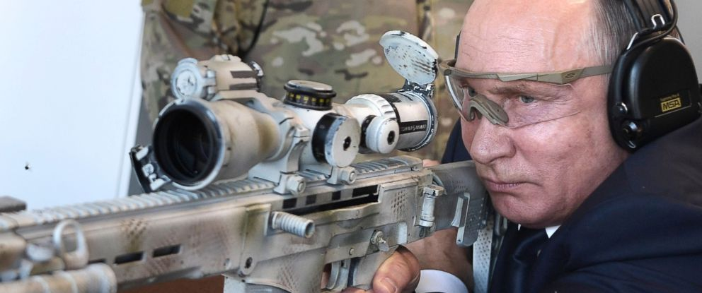 PHOTO: Russian President Vladimir Putin shoots from a Chukavin sniper rifle (SVCh 380) at Kalashnikov Concern shooting club at the military patriotic park Patriot in Kubinka, near Moscow, Sept. 19, 2018.
