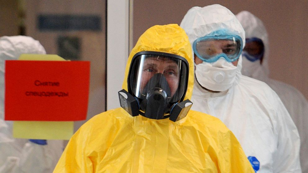Putin dons hazmat suit, as Russia admits virus numbers likely far higher