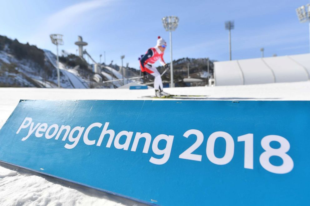 PHOTO: Cross-country skiers in action behind a band with the text Pyeongchang 2018 in the Alpensia Cross-country Skiing Centre in Pyeongchang, South Korea, Feb. 7, 2018.