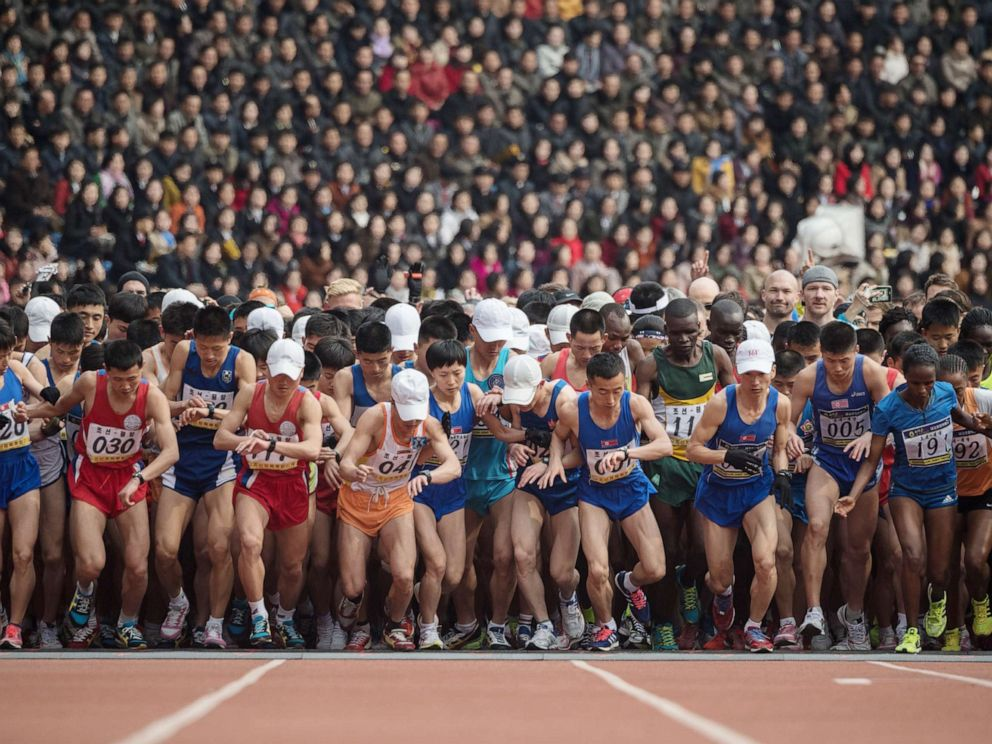 PHOTO: Competitors cross the start line of the the annual Pyongyang marathon at Kim Il Sung stadium in Pyongyang in this April 8, 2018 file photo.