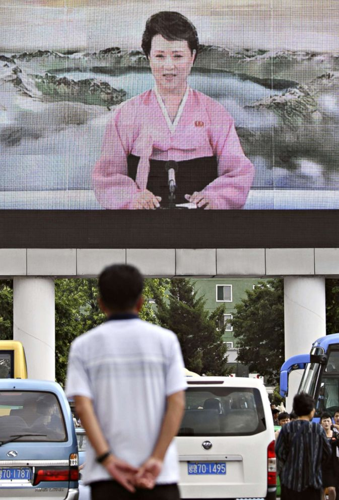 PHOTO: A man looks at a public screen on June 12, 2018 set up near Pyongyang station showing North Korean leader Kim Jong Un in Singapore for his meeting with President Donald Trump.