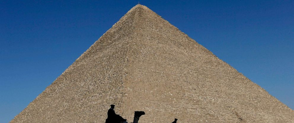 PHOTO: In this Dec. 12, 2012, file photo, policemen are silhouetted against the Great Pyramid in Giza, Egypt.