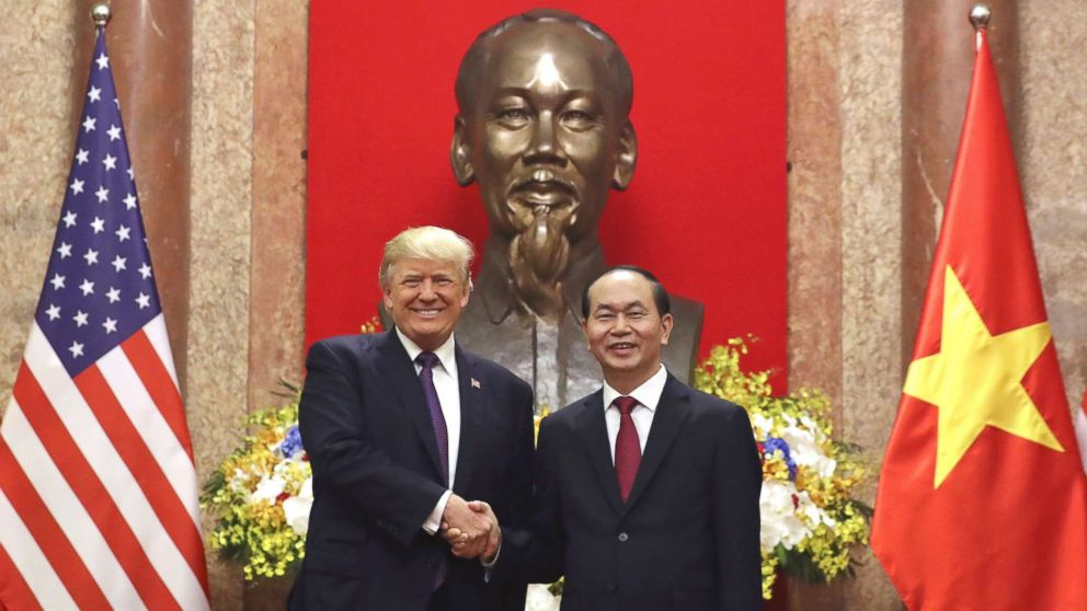 President Donald Trump, left, and Vietnamese President Tran Dai Quang shake hands at the Presidential Palace, Nov. 12, 2017, in Hanoi, Vietnam.
